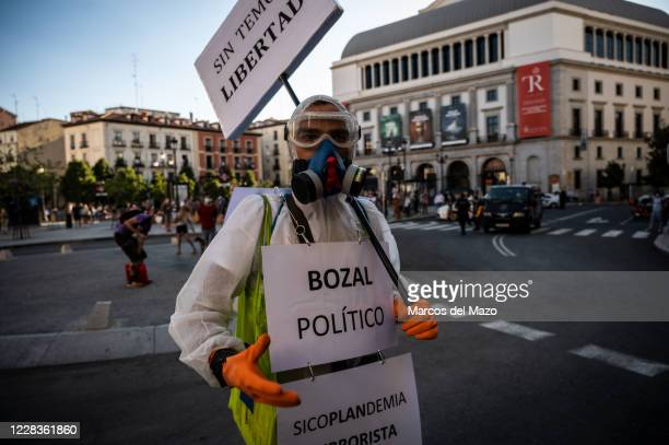 Man wearing IPE protesting during a demonstration against the mandatory use of face masks, the use of a vaccine against coronavirus, the...