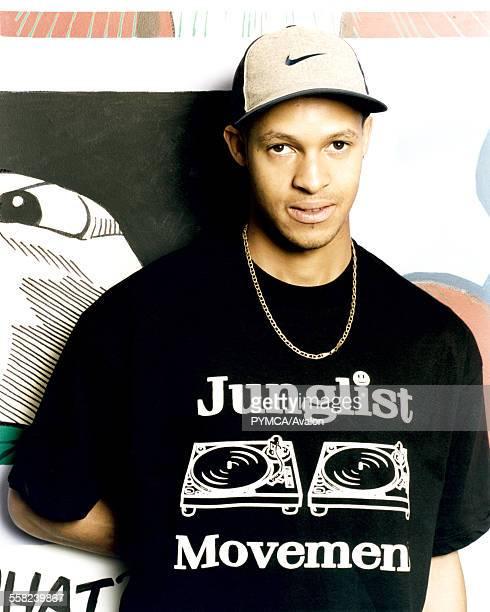 Man wearing Junglist Movement tshirt and Nike basball cap UK 1990s