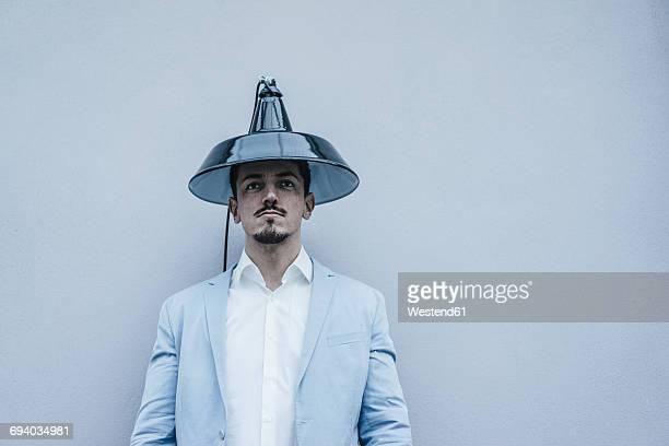 Man wearing lampshade as hat