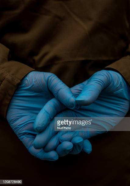 Man wearing latex gloves in the subway in Istanbul, Turkey during coronavirus quarantine on March 30, 2020. Turkish minister of health stated on...