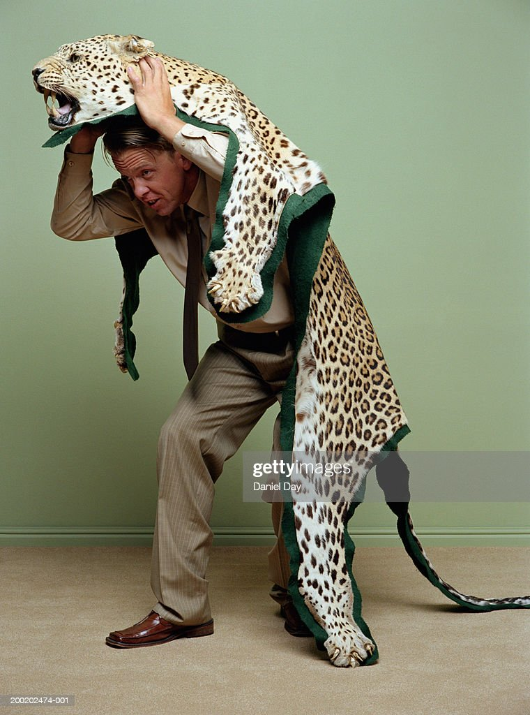 man-wearing-leopard-skin-rug-picture-id2