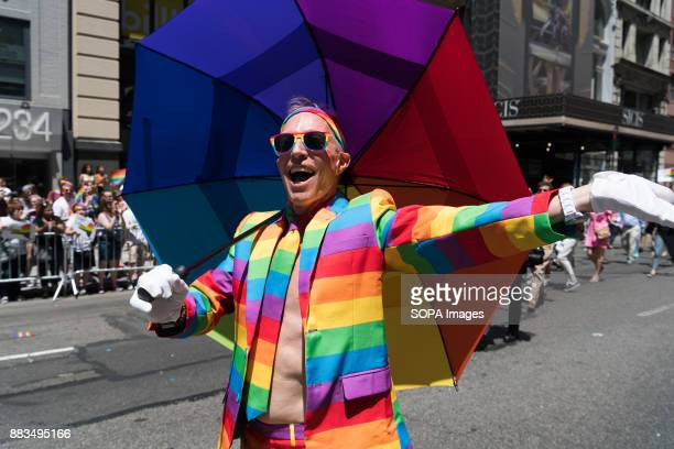 A man wearing LGBT colors seen walking through the parade at the Pride March in New York City