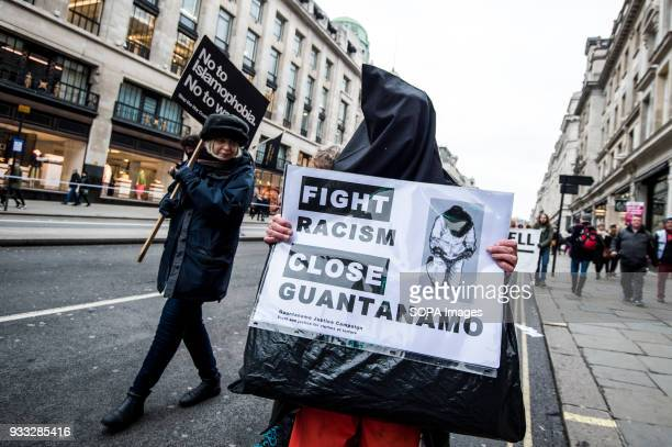 A man wearing like Guantanamo's prisoners during the march Thousands of people took to the street of London for the march against racism four days...