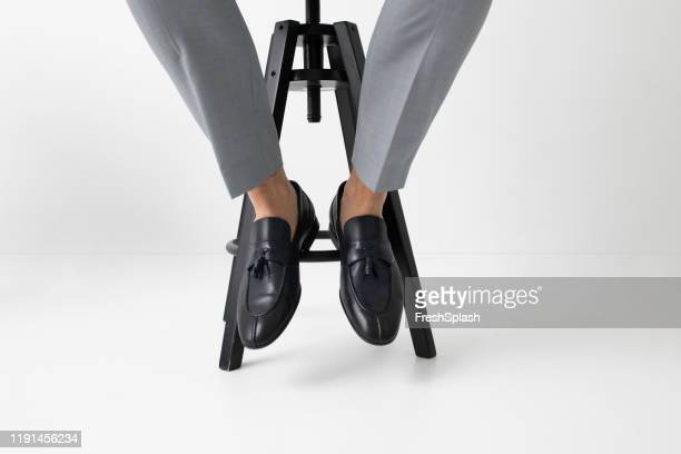a man wearing loafers - loafer stock pictures, royalty-free photos & images
