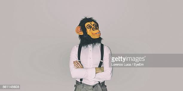 Man Wearing Mask Against White Background