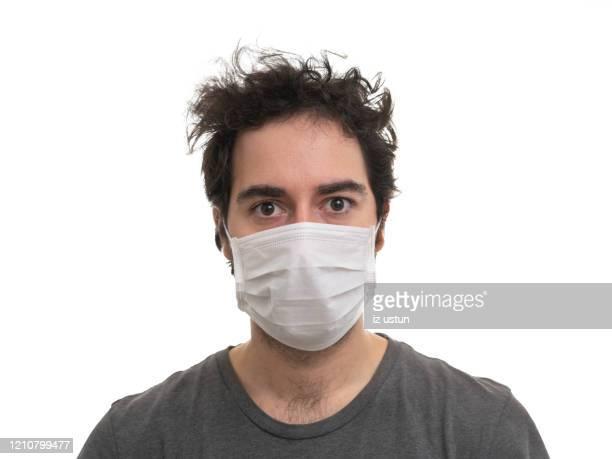 man wearing mask - maske stock-fotos und bilder