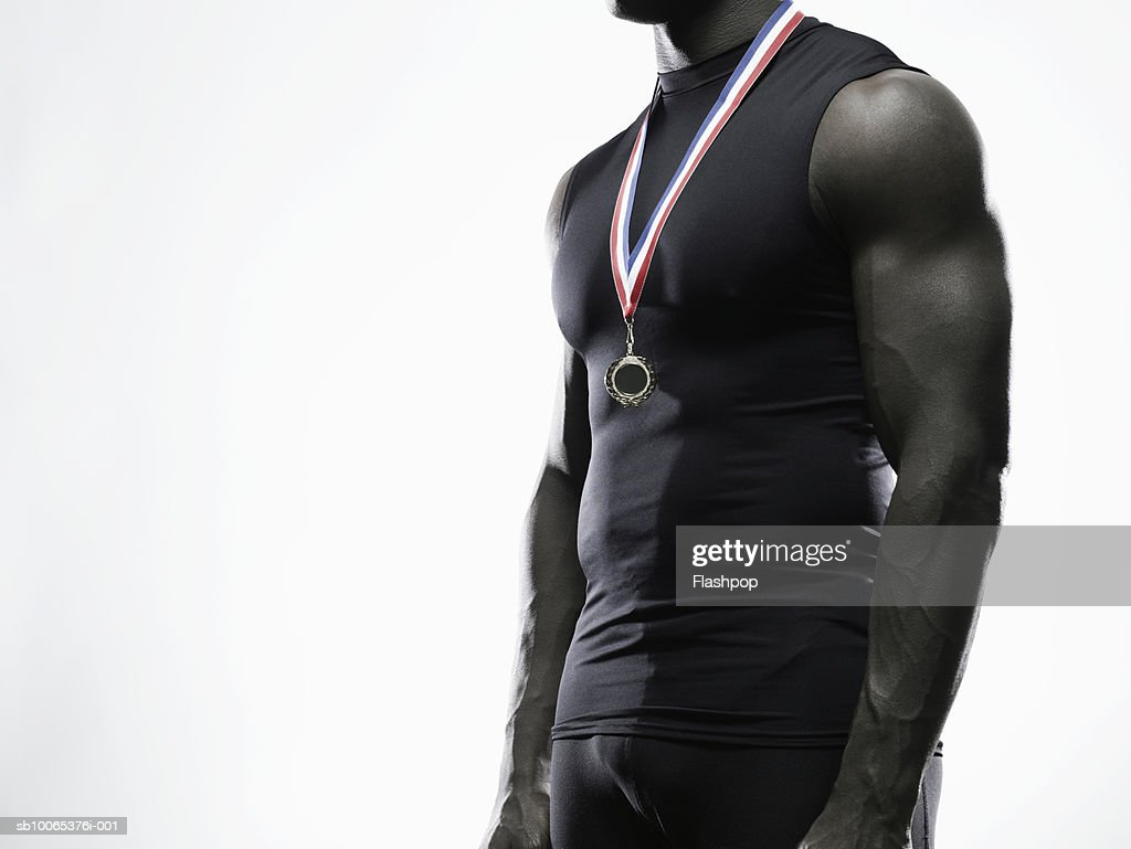 Man wearing medal, mid section, close-up : Foto stock