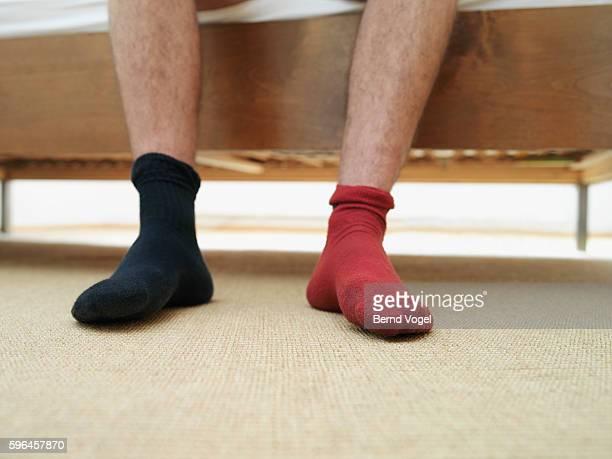 man wearing mismatched socks - calcetín fotografías e imágenes de stock