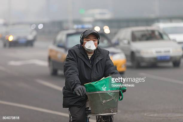 Man wearing mouth mask with filter against air pollution, Beijing