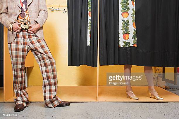 man wearing name belt - fitting room stock pictures, royalty-free photos & images