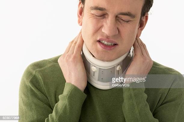 Man Wearing Neck Brace
