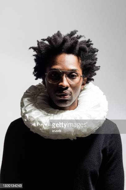 man wearing neck ruff - african ethnicity stock pictures, royalty-free photos & images