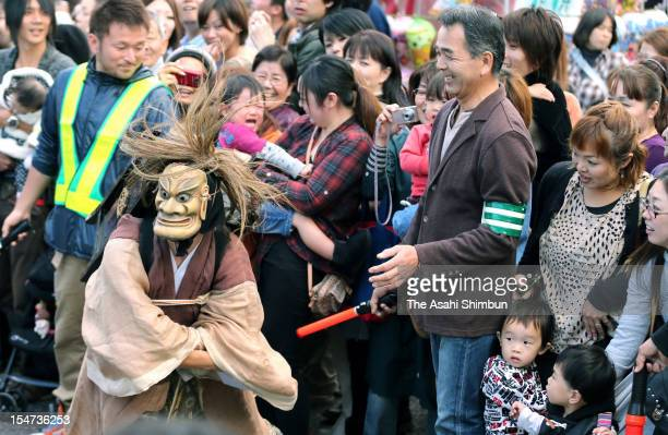 A man wearing ogre mask marches on during the Ueno Tenjin Festival on october 24 2012 in Iga Mie Japan