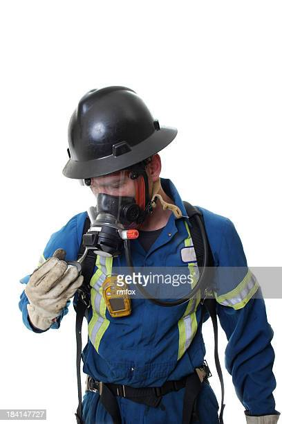 Man wearing oilfield safety clothes on a white background