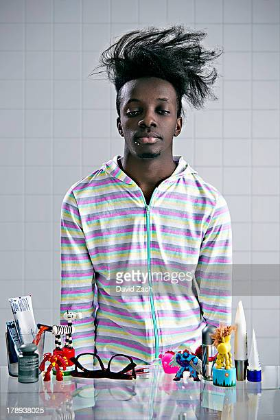 Man wearing onesie, looking into bathroom mirror