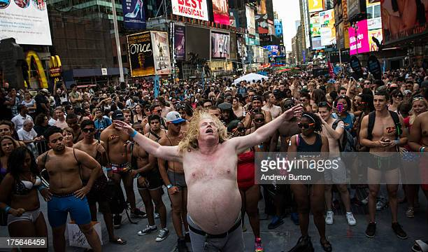 A man wearing only his underwear dances in front of a crowd in Times Square in an attempt to break the Guinness Book of World Records' record for...