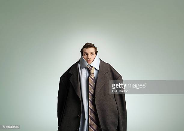 man wearing oversized suit - oversized stock pictures, royalty-free photos & images
