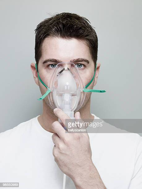 man wearing oxygen mask. - breathing device stock pictures, royalty-free photos & images