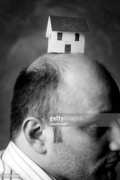 Man Wearing Paper House on Head, Black and White