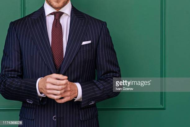 man wearing pinstripe blazer with spotted tie - striped suit stock pictures, royalty-free photos & images
