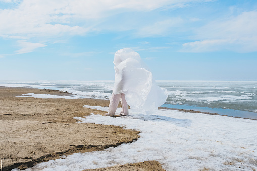 Man Wearing Plastic Against Sky, Sands and Ice - gettyimageskorea