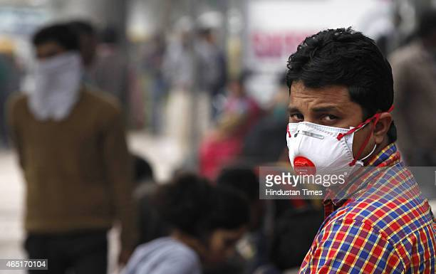 A man wearing precautionary mask in the wake of Swine Flu epidemic at Delhi Road on March 3 2015 in New Delhi India According to health ministry...
