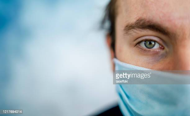 man wearing protective face mask - emergencies and disasters stock pictures, royalty-free photos & images
