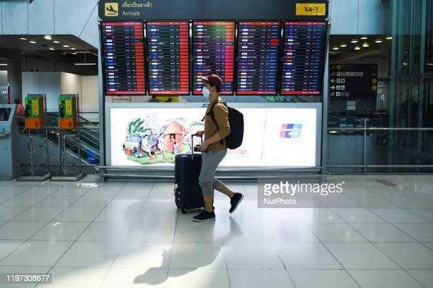 Man wearing protective masks at Suvarnabhumi Airport in Bangkok, Thailand, 29 January 2020.