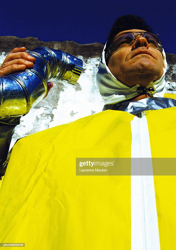 Man wearing protective suit, low angle view : Stockfoto
