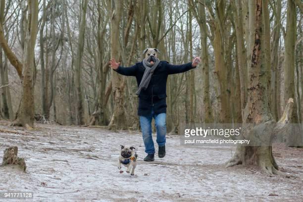 Man wearing pug mask with pug