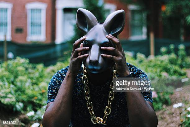 man wearing rabbit mask - rabbit mask stock pictures, royalty-free photos & images