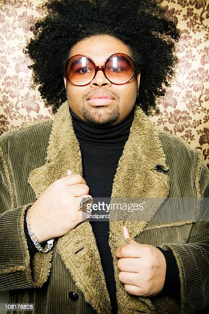 man wearing retro sunglasses and corduroy jacket - all hip hop models stock photos and pictures