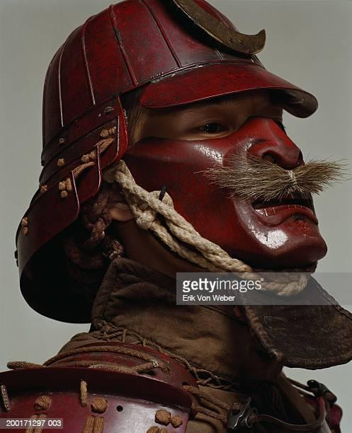 Man wearing samurai helmet and mask