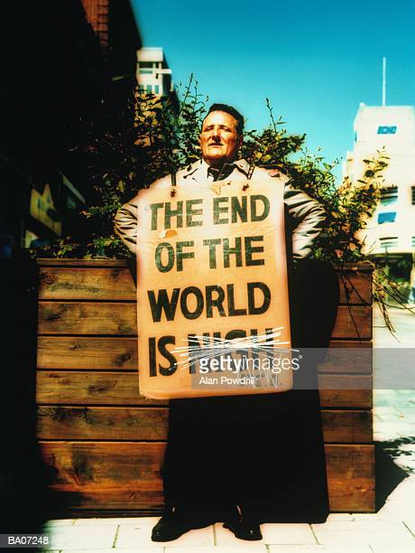 Man wearing sandwich board sign on street