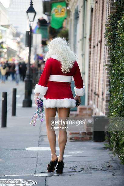 man wearing santa costume- new orleans french quarter, mardi gras - new orleans christmas stock pictures, royalty-free photos & images