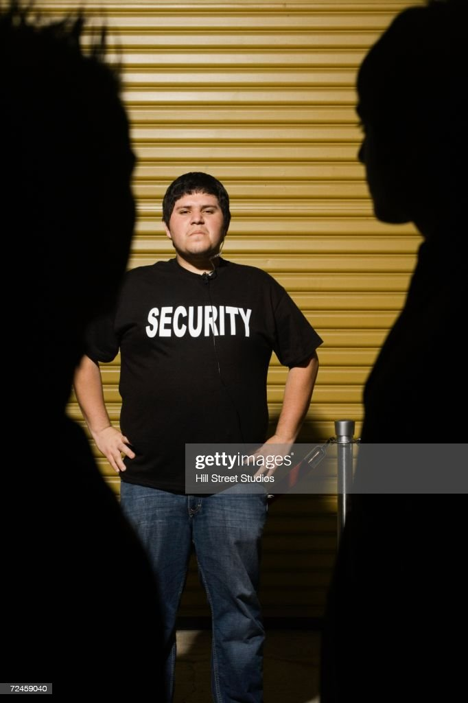 Man wearing Security shirt with hands on hips : Stock Photo
