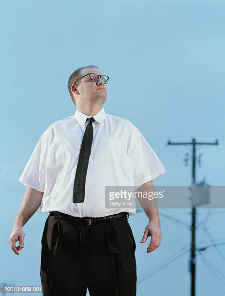 man wearing shirt and tie standing outdoors, blue sky background - hero and not superhero stock pictures, royalty-free photos & images
