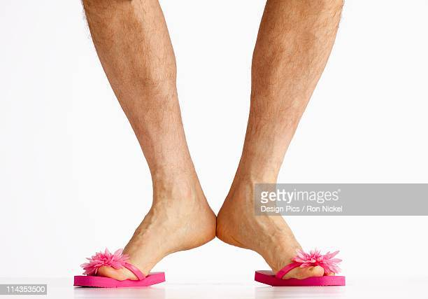 A Man Wearing Small Pink Flip Flops