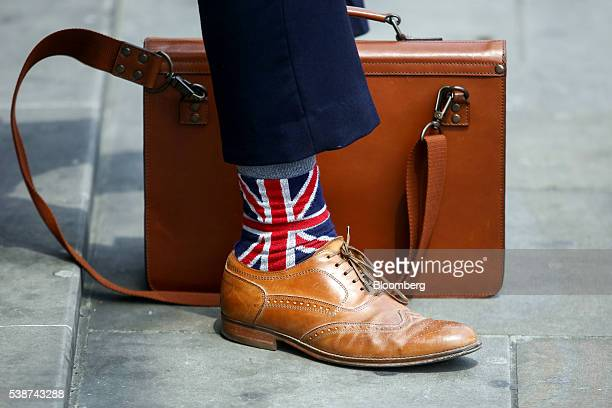 A man wearing socks featuring the design of the British Union Flag commonly known as a Union Jack stands in London UK on Tuesday June 7 2016 UK Prime...