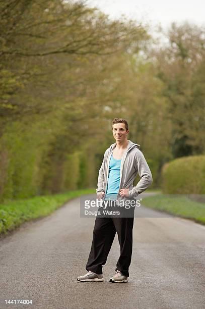 Man wearing sportswear in countryside.