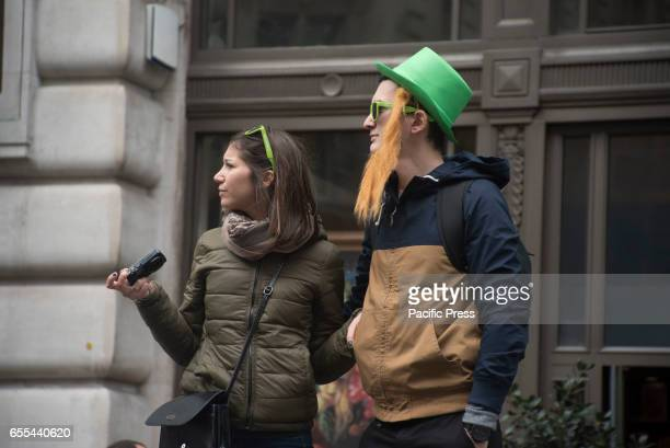 A man wearing st Patrick's beard and hat during the traditional St Patricks Day parade with flag bearers elaborates floats and marching bands The...