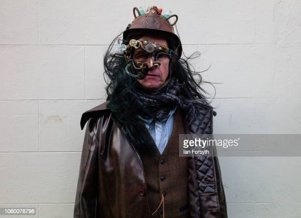 A man wearing steam punk clothing poses for photographs during Whitby Goth Weekend on October 27 2018 in Whitby England The Whitby Goth weekend began...