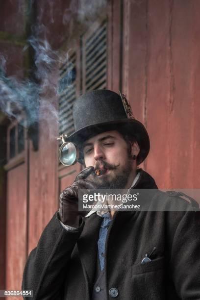 Man wearing steampunk costume and smoking cigars