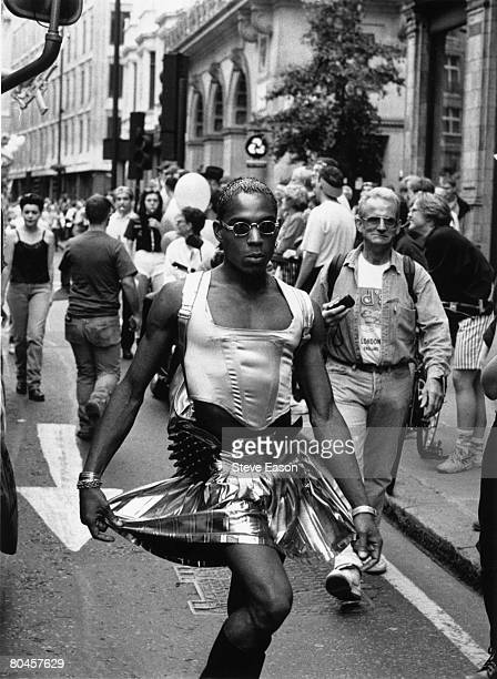 A man wearing strange clothing walking down a street in London on the day of the Gay Pride march 26th June 1995