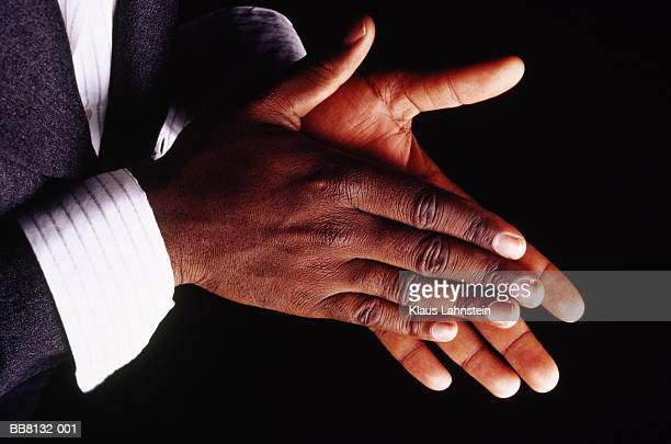 Man wearing suit clapping hands, close-up