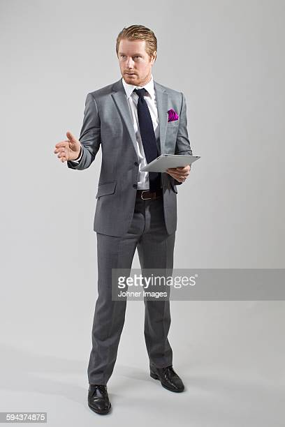 man wearing suit, studio shot - grey suit stock pictures, royalty-free photos & images
