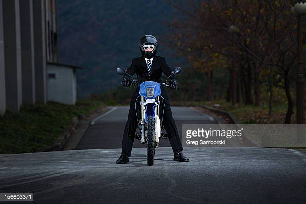 Man Wearing Suit Tie and Sunglasses on Dirt Bike