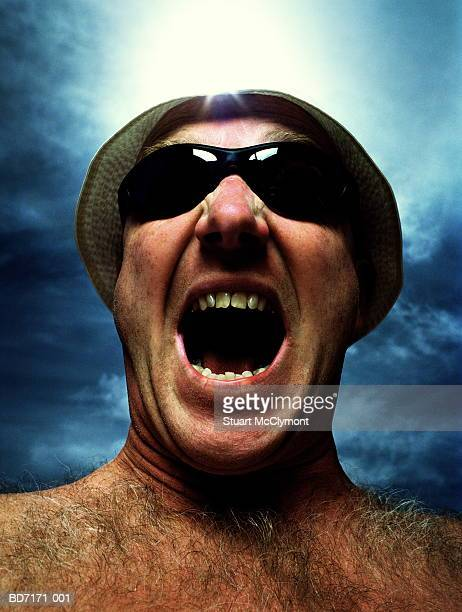 man wearing sunglasses and hat, mouth wide open, close-up - hairy man chest stock photos and pictures