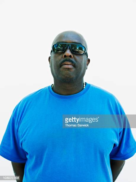 man wearing sunglasses  - fat black man stock photos and pictures