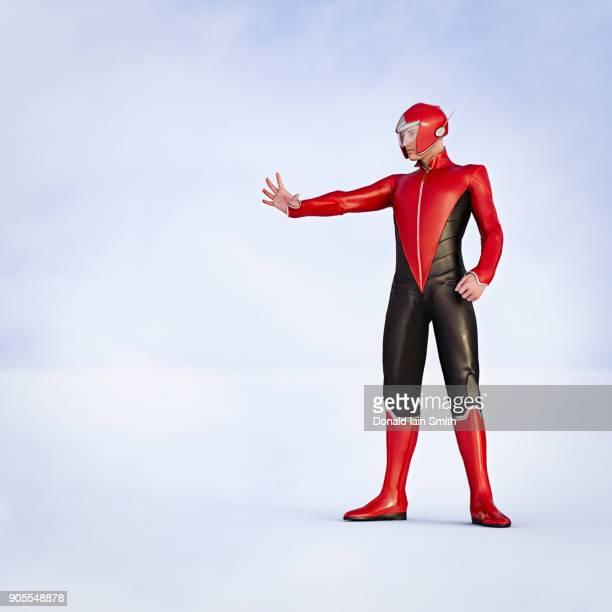 man wearing superhero costumes gesturing stop - superhero stock pictures, royalty-free photos & images